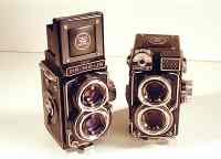 Two Primo-Jr cameras, one with light meter